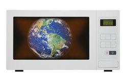 Global warming - earth in microwave Royalty Free Stock Photos