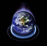 Global Warming. Earth planet on a gas stove burner. The planet earth image provided by NASA Stock Photo
