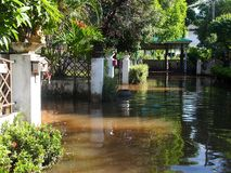 Global warming effect in town, low level flood water in urban zone stock image