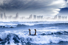 Global warming and extreme weather concept. Man drowning in the water and storm destroyed the city Royalty Free Stock Photography