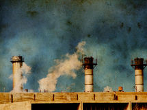 Global Warming / industrial pollution. Against a grungy distorted grain texture stock images
