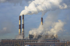 Global warming pollution. Air pollution of old Soviet thermal power plant. Cold winter time Stock Photography