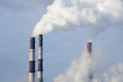 Global warming pollution. Air pollution of thermal power plant. Cold winter time Stock Photos