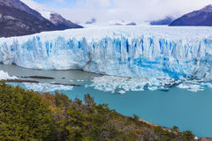The global warming problem. The warming of the atmosphere affects large frozen water supplies and leads to disappearing glaciers and sea level rise Stock Image