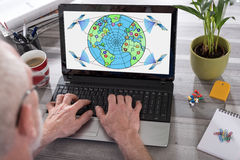 Global web network concept on a laptop screen. Global web network concept shown on a laptop used by a man Royalty Free Stock Photography