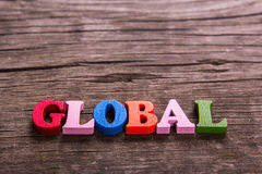 Global word made of wooden letters Stock Images