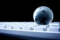 Global world on keyboard in technology network. On black background digital internet stock photo