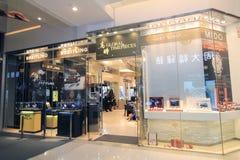 Globala ur shoppar i Hong Kong Arkivbilder