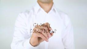 Globale Oplossingen, Zakenman Writing op Glas stock foto's