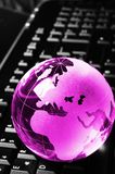 Globalisation. Concept with glass planet on computer keyboard and copyspace royalty free stock photography