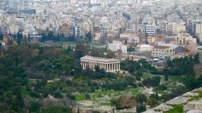 Globalisation. An ancient temple against the modern buildings. Athens stock images