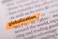 Globalization. The word Globalization from dictionary marked by orange Stock Photo