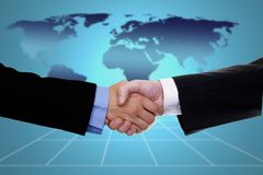 Globalization. Handshake over world map, business or politic concept indicating globalization Royalty Free Stock Photo