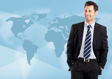 Globalization. Young attractive businessman with world map in background - globalization Stock Images