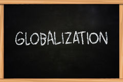 Globalization. Business concept the words Globalization written with chalk on blackboard royalty free stock photos