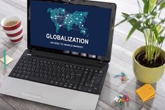 Globalization concept on a laptop. Laptop on a desk with globalization concept on the screen stock photo