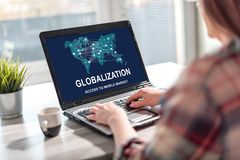 Globalization concept on a laptop screen. Laptop screen displaying a globalization concept stock photos