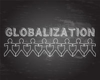 Globalization People Blackboard. Globalization hand drawn text and cut out paper people chain on blackboard background Royalty Free Stock Images