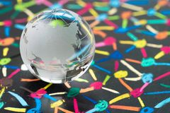 Globalization, social network or connectivity world concept, small decoration globe with China and Asia map on colorful pastel. Link and connect chalk line royalty free stock image