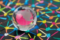 Globalization, US trade or world commerce, import, export or con. Nectivity concept, small decoration globe with colorful pastel link and connect chalk line royalty free stock image