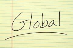 Globalt på ett gult lagligt block Arkivbild