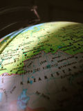 Globe. A detail of a toy globe, lighted on a slice only, macro take, Kazakstan in the foreground out of focus Stock Photos