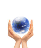 Globe. Blue globe in the hands Royalty Free Stock Images