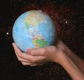 Globe. In hands on space background Stock Photos