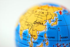 Globe. Macro shot of a toy globe showing China Royalty Free Stock Image
