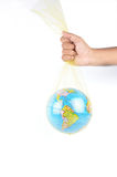 Globe. The man hand caring a world simply Royalty Free Stock Photography