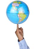 Globe. A man taking a globe in his finger Royalty Free Stock Photo