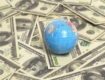 Globe. On US hundred dollar bills Royalty Free Stock Photos