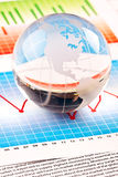 Globe!. Office desk arrange in studio. Glassy Globe placed on diagrams Royalty Free Stock Images