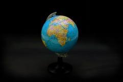Globe. Dark background royalty free stock photography