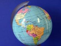 Globe. Colorful globe isolated on blue background Stock Photography