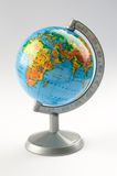The globe. Little globe on a white background stock images
