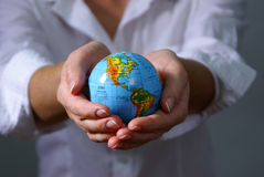 Globe. On hands businesswoman hands Stock Photography