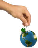 Globe. Hand holds the key on a chain with a globe Royalty Free Stock Images