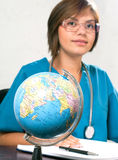 Globe. BackgroundGlobe in front of a medical doctor on white Stock Photography