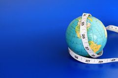 Globe. Image of a globe and a tape measure representing a weight loss on a global scale Stock Image