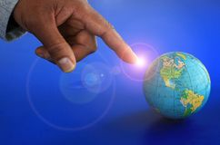 Globe. Image of a globe and a businessman pointing at it stock photo