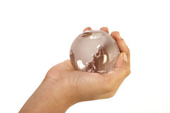 Globe. In the hand showing the world Stock Photography