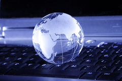 Globe. Placed on a keyboard , showing the world Stock Photography