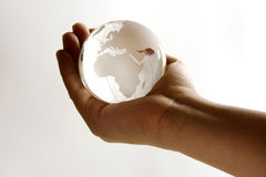Globe. A globe in the hand showing the world Royalty Free Stock Image