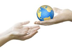 Globe. Hand gives globe in other hands