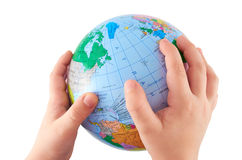 Globe. In children's hands on an isolated white background Stock Images