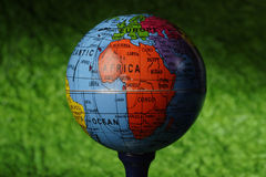 Globe. On a Golf Tee Royalty Free Stock Image