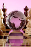 Globe. Placed on a chess board Royalty Free Stock Photography