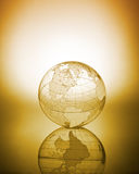 Globe. Transparent Glass Globe backlit brown tone Royalty Free Stock Photos