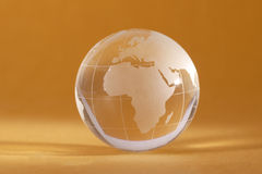 Globe. A crystal globe showing the world tied up with a metal chain Royalty Free Stock Image